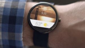 Moto 360 shown running Android Wear.